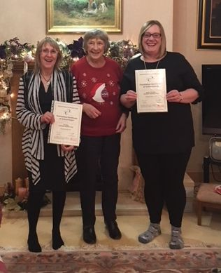 Tio White and Susan Thomson receiving their Foundation Certs from Lorna Henry at the KSC Christmas party